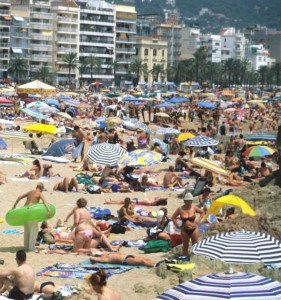 High-volume, low-margin beach tourism in Spain. Photo: Jonathan Tourtellot