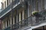 French Quarter balconies defy modern pressures in New Orleans. Photo: Jonathan Tourtellot
