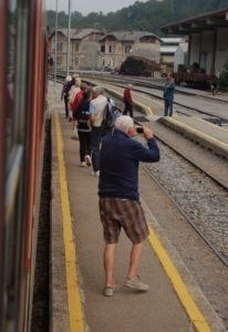 Tourists disembark at a Slovenia railway station.