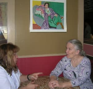 New DMO director Tylene Boley (left) meets with geotourism leader Elaine Parny in Elaine's restaurant. Photo: Linea Iantria