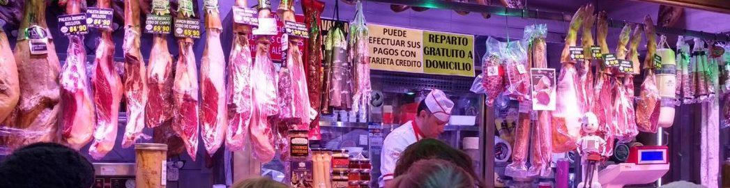 A meat vendor at the Mercado de Antón Martín
