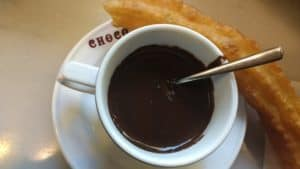 A Spanish porra (thicker cousin to the churro) and chocolate (for dunking)