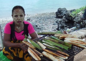 A Comoro vender uses paste made from powdered tree bark for sun protection. Photo: Andy Dumaine